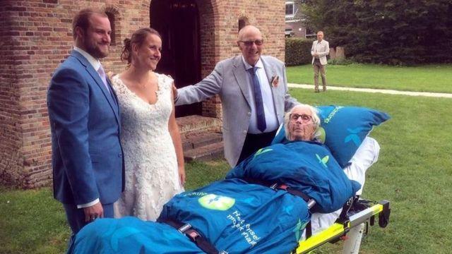 Elderly woman escorted to a hastily arranged wedding