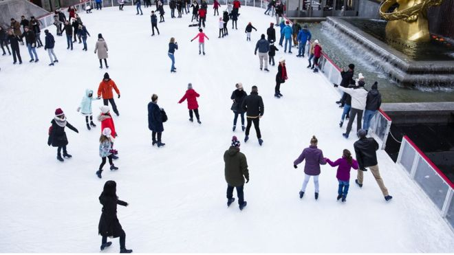 People skate at the ice-skating rink at Rockefeller Center