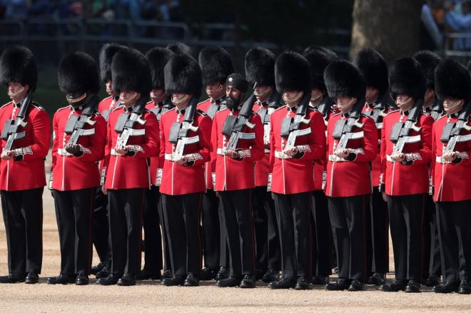 Coldstream Guards soldier Charanpreet Singh Lall marches during Trooping The Colour parade on 9 June