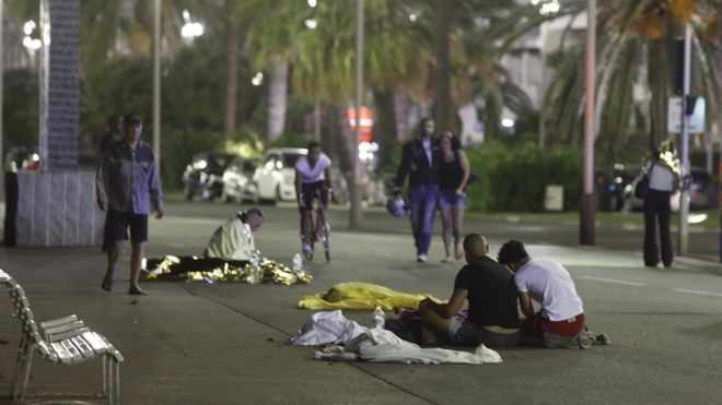Aftermath of the attack, with covered bodies on ground