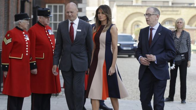 First Lady Melania Trump, is accompanied by Philip May, the husband of British Prime Minister Theresa May as she meets British military veterans known as 'Chelsea Pensioners' at Royal Hospital Chelsea on July 13, 2018 in London, England.