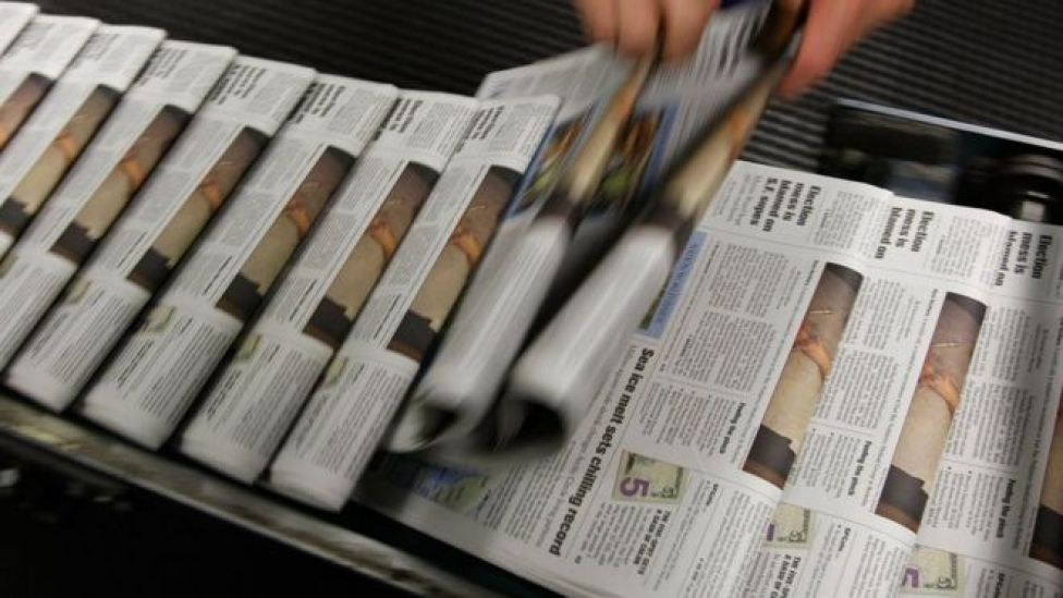 newspapers on a rack from 2007