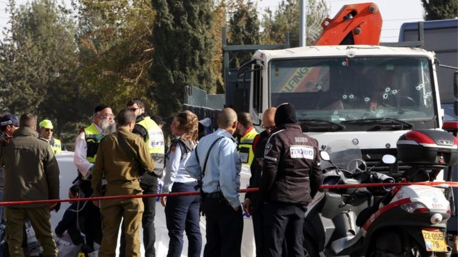 Israeli security forces and medics gather at the site of a ramming attack in Jerusalem on January 8, 2017