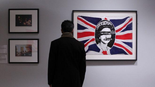 A man views a work depicting Britiain's Queen Elizabeth II entitled