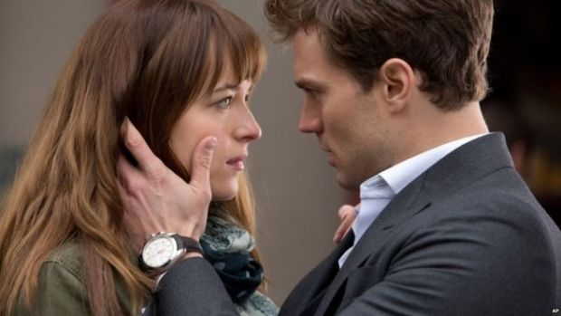 Dakota Johnson and Jamie Dornan appear in Fifty Shades of Grey
