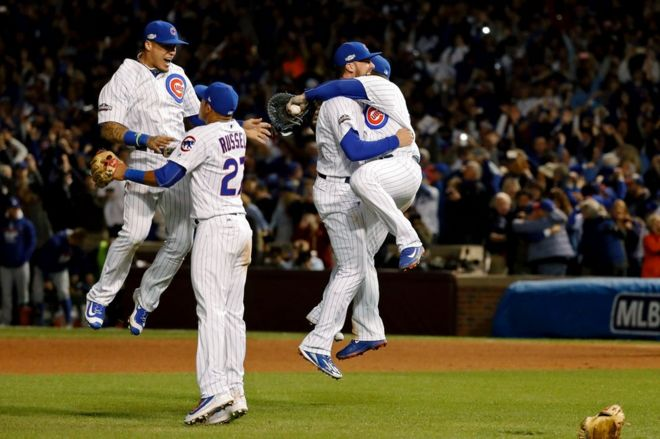The Chicago Cubs celebrate after winning Game 6 of the 2016 NLCS playoff baseball series at Wrigley Field, 22 October