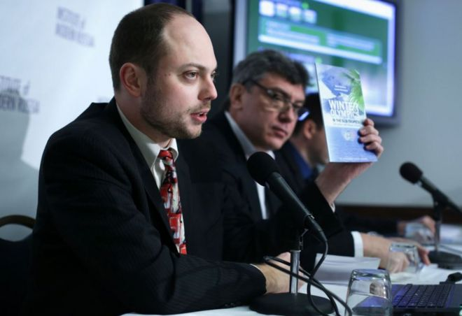 Vladimir Kara-Murza (left) holds up a copy of the report on 'Winter Olympics in the Sub-Tropics' with Russian opposition leader and former Deputy Prime Minister Boris Nemtsov