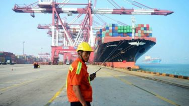 A man stands on a port in China