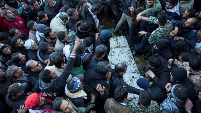 Mourners attend the burial of Qasem Soleimani
