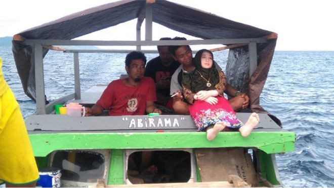 A recent undated handout picture released by Indonesian police and made available on 3 May 2016 shows an Indonesian man holding a sex doll in Banggai in Sulawesi.