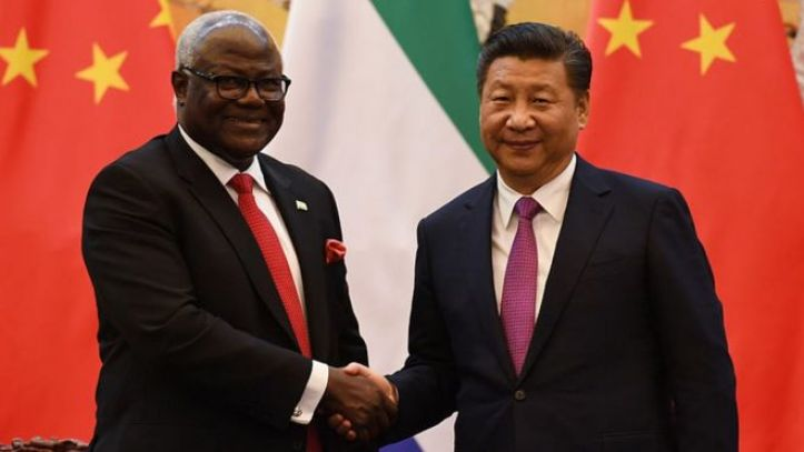 Former Sierra Leone President Ernest Bai Koroma (L) and Chinese President Xi Jinping shake hands during a signing ceremony in Beijing's Great Hall of the People on December 1, 2016.