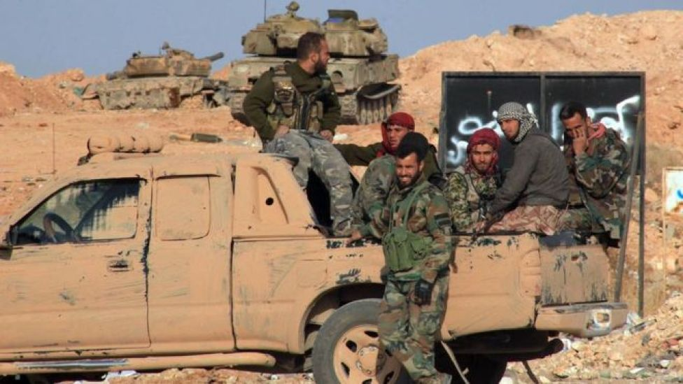 Syrian government forces deployed on a road south-east of Aleppo (4 November 2015)