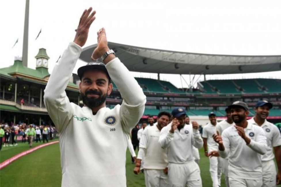 "India""s captain Virat Kohli gestures to supporters as his teammates celebrate a 2-1 series victory over Australia following play being abandoned on day five in the fourth test match between Australia and India at the SCG in Sydney, Australia"