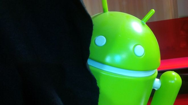 Android mascot behind a curtain