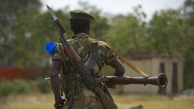 South Sudanese People Liberation Army (SPLA) soldier patrols in Malakal on 21 January 2014.