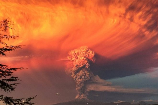 Smoke and ash rise from the Calbuco volcano as seen from the city of Puerto Montt, Chile, 22 April 2015
