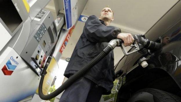 Attendant James Lewis pumps gas at a station in Portland, Oregon