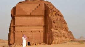 Man stands outside of the Qasr al-Farid tomb in Madain Saleh, a UNESCO World Heritage site, near the town of al-Ula in Saudi Arabia