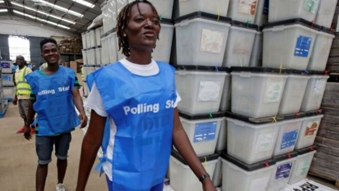 lection workers walk past ballot boxes and voting materials at the National Electoral Commission headquarters in Monrovia, Liberia October 9, 2017