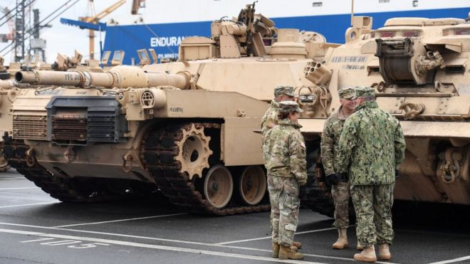 U.S. tanks, trucks and other military equipment, which arrived by ship, are unloaded in the harbour of Bremerhaven, Germany January 8, 2017