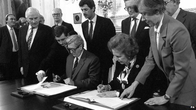Margaret Thatcher and Garret FitzGerald signing the Anglo-Irish Agreement