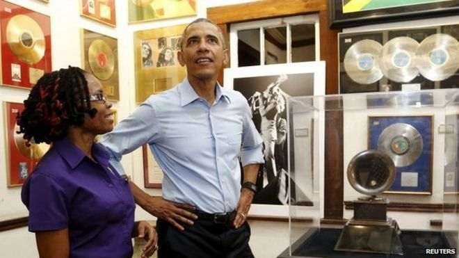 U.S. President Barack Obama gets a tour of the Bob Marley Museum from a staff member Natasha Clark (L) in Kingston, Jamaica April 8, 2015.