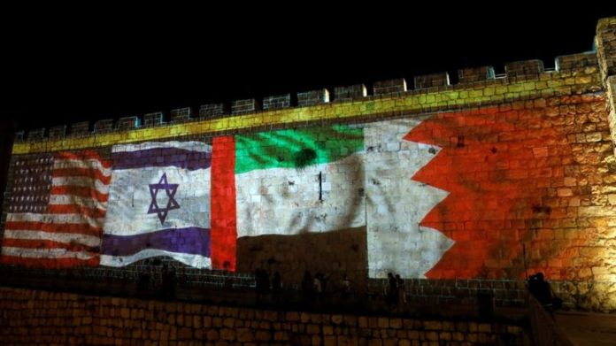 The US, Israeli, UAE and Bahraini flags are projected on to the walls of Jerusalem's Old City on 15 September 2020