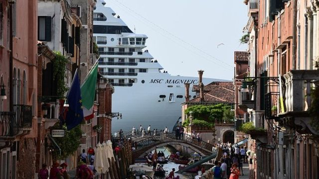 A cruise ship seen from a Venice canal