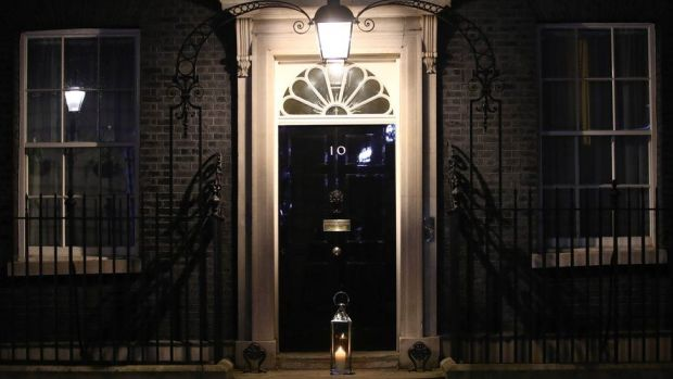 A candle is placed on the doorstep of 10 Downing Street, London