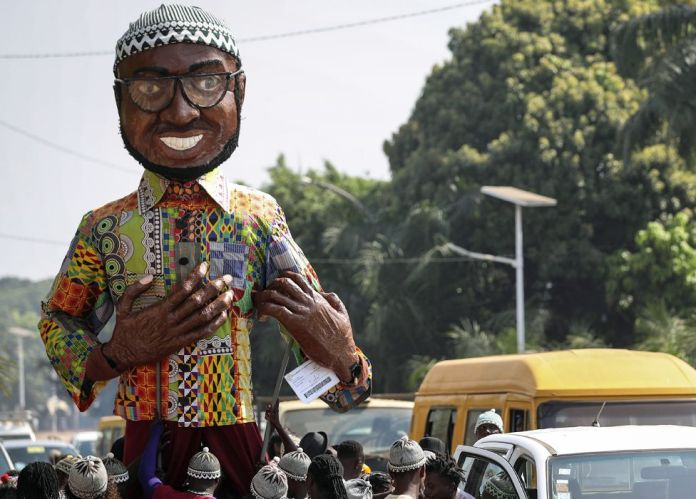 A giant puppet of Amílcar Cabral seen on the streets of Bissau, Guinea-Bissau - Thursday 21 November 2019