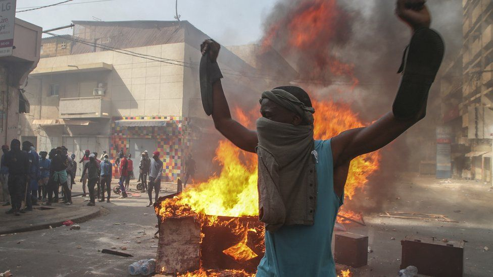 Opposition supporters of leader Ousmane Sonko clash with security forces during a protest in Dakar, Senegal 5 March 2021