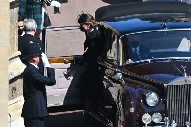 Catherine, Duchess of Cambridge, arrives in the quadrangle ahead of the ceremonial funeral procession of Britain's Prince Philip, Duke of Edinburgh to St George's Chapel in Windsor Castle in Windsor,