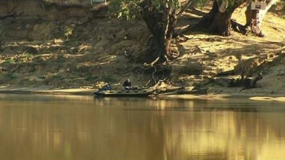 Police examine the Murray River on the Victoria-New South Wales border