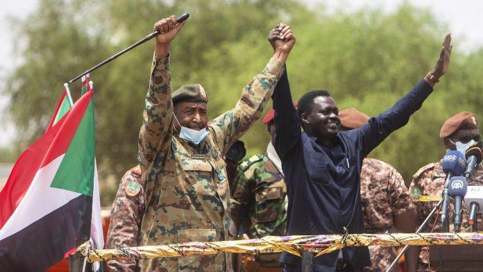Lt-Gen Abdel Fattah Abdelrahman Burhan (L) next to newly inaugurated Darfur governor Minni Minawi in el-Fasher, Sudan - Wednesday 8 August 2021