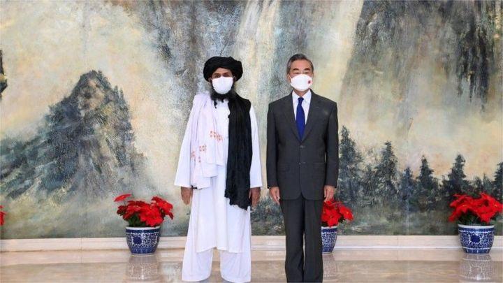 wang yi with mullah baradar