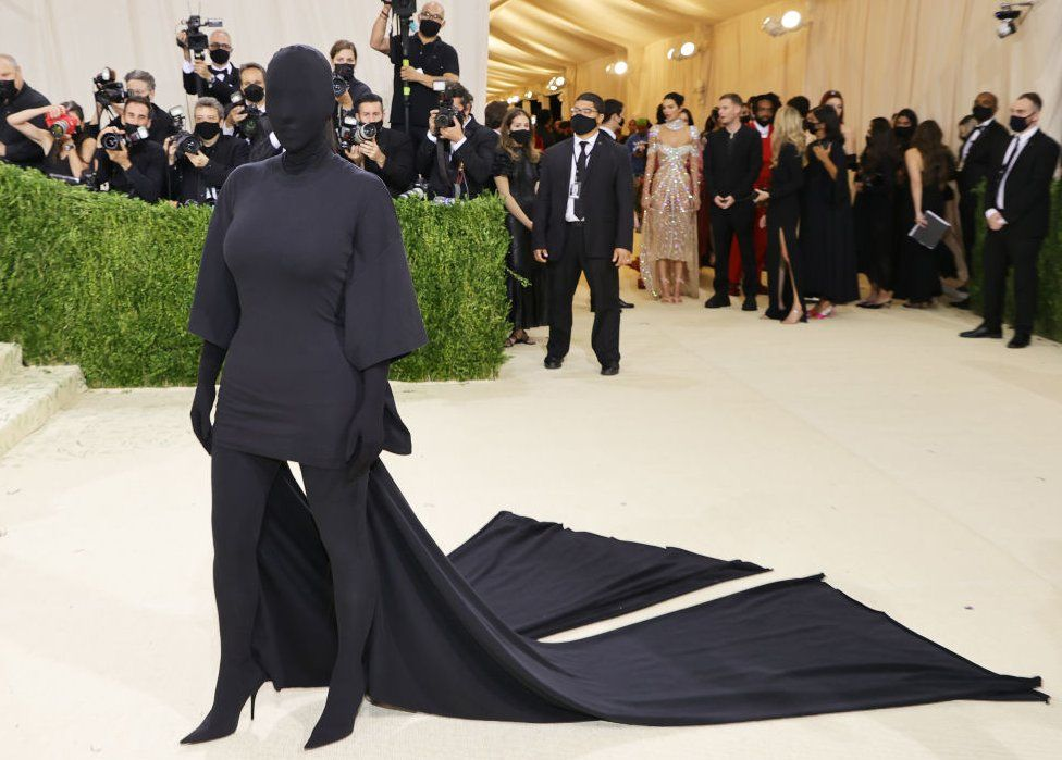 Kim Kardashian dressed in an all-enveloping black outfit that also covers her face