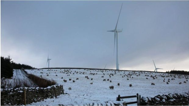 Wind turbines on a snowy Scottish hillside