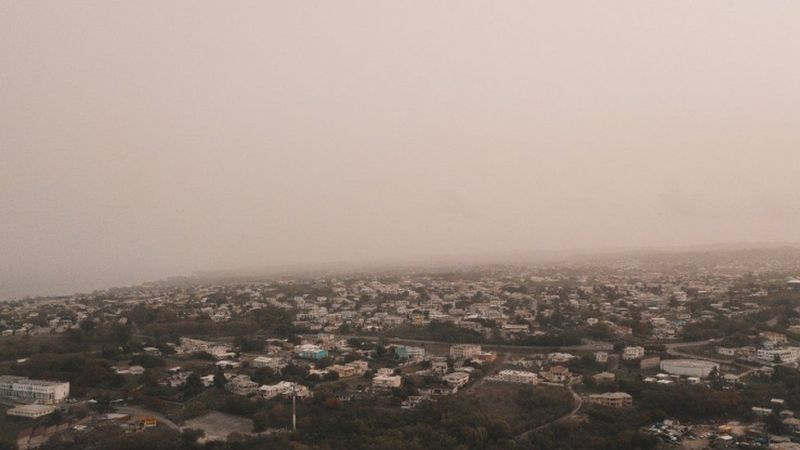 Dust coming from the Sahara desert floats over the city of Bridgetown, Barbados, June 22, 2020, in this picture obtained from social media
