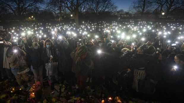 Hundreds turn on their phone torches at the bandstand in Clapham Common