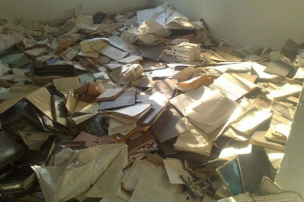Documents cover the floor of Baath Party offices, northern Syria (September 2013)