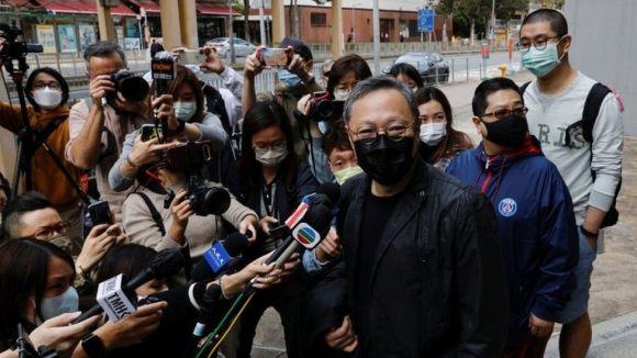Veteran campaigner Benny Tai reports to police