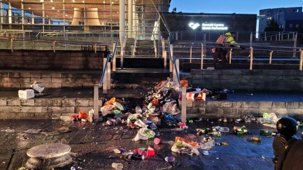 Litter piled up on the steps of the Senedd at Cardiff Bay