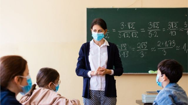 teacher in class with mask