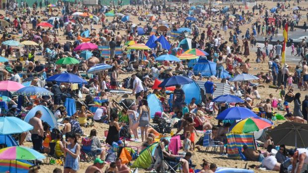 Crowds enjoy the sunshine on Bournemouth beach in Dorset on Bank Holiday Monday