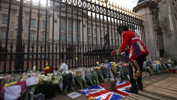 Flowers and tributes left outside Buckingham Palace