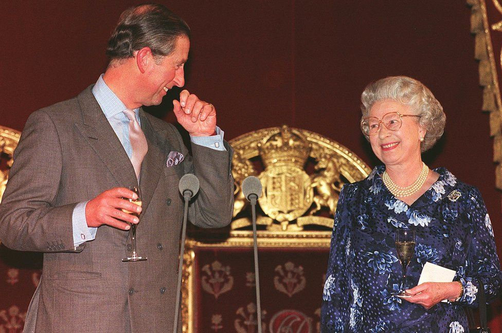 Prince of Wales smiling at his mother Queen Elizabeth II