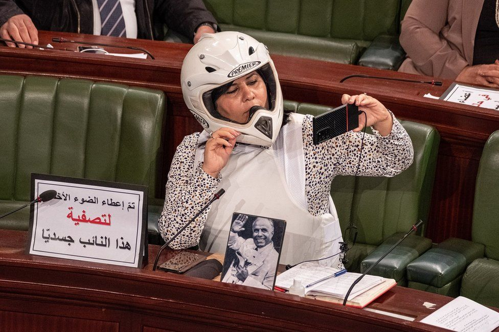 Abir Moussi wearing a helmet and a flak jacket in parliament
