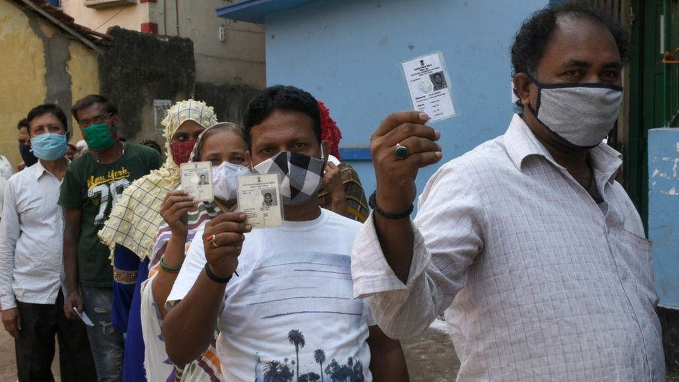 Voters showing their Voter Identity Cards before enter the Polling Booth at Kolkata