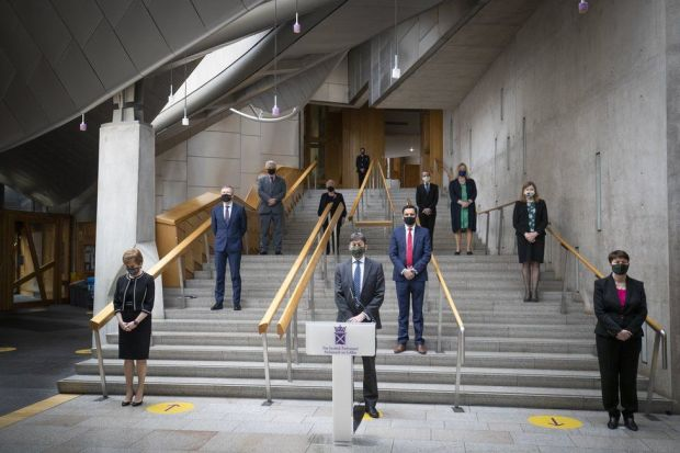 Members of the Scottish Parliament observe a minute's silence