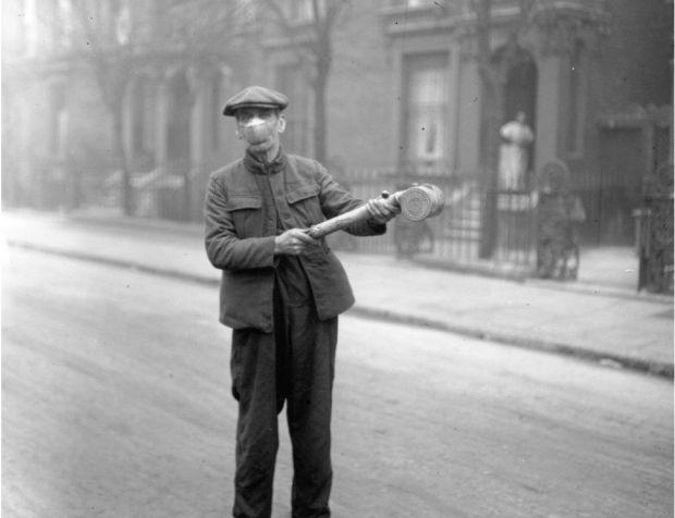man wielding a spray